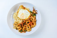 Spicy stir fried squid with basil leaves and chili, Sunny side up egg