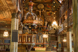 Pulpit and altar piece in an old Wooden Church