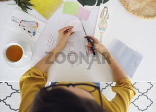 Young brunette woman creating her Feng Shui wish map