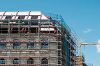 building under construction / restoration - scaffoling on building facade -