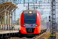 . Russian electric train on rails . The railways of Russia, Russia, Leningrad region, Pargolovo station, May 8, 2018, a tour of the cities and villages spring-summer