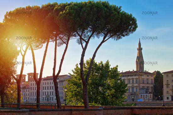Florence riverfront landmarks sun haze view