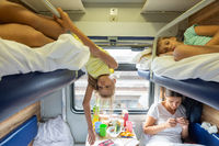 Children are tired of riding in a reserved seat train car without air conditioning for a long time