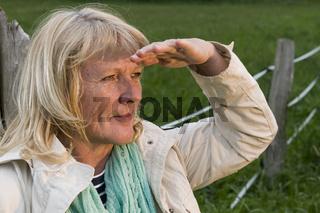 blond mature woman look at camera
