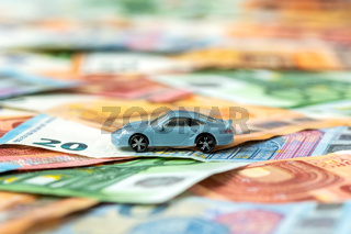 Car model on money background