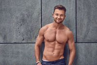 Relaxed handsome fit muscular young man
