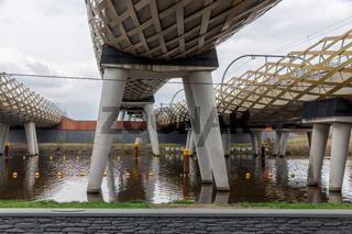 Modern railway bridge across river Dieze in Dutch city s-Hertogenbosch