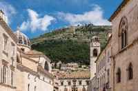 Hillside rises above the bell tower in Dubrovnik old town