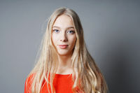 young woman with long blond hair and blue eyes