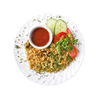 Pilaf rice with meat and vegetables and sauce on the plate, isolated on white background. Top view