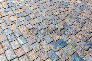 Background of cobblestones making from rough stone blocks