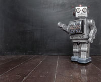 retro  teacher  silver robot and a black board