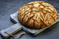 Artisanal Finnish rye bread on a wooden board.