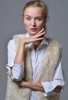 beautiful blonde woman in fur jacket.