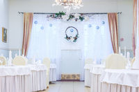 Christmas decoration of the hall in the restaurant. Holiday in the restaurant. New Year's decor. White scenery. The interior. Russia Big Kolpany, restaurant Chalet December 7, 2018