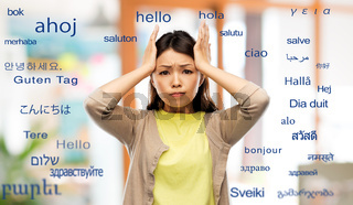 stressed asian woman over foreign words