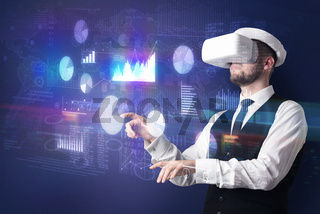 Man wearing VR goggles with charts and reports