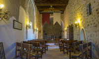 wooden seats, Interior of a medieval castle in Toledo, Spain. Stone rooms with wooden furniture, medieval period of the Spanish reign
