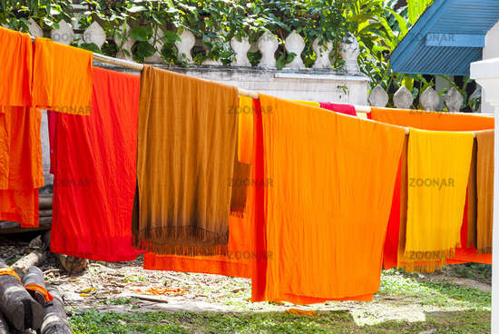 Orange clad robes drying outside