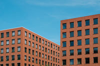 red brick building blocks and blue sky - real estate  concept