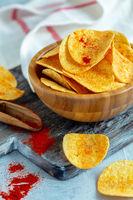 Bowl of paprika potato chips.