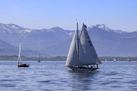 White sails and snow on the peaks, Lake Constance, landscape in May