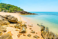 Natural landscape of sea and tropical island with rocks on beach