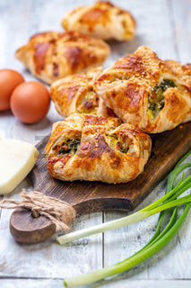 Homemade puffs with spinach, egg and green onions.