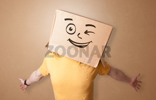 Young man  with happy cardboard box face