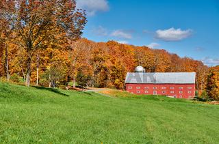 Farm near highway at autumn day, Vermont, USA.