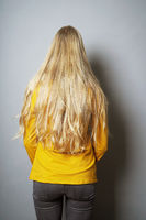 rear view of young woman with long blond hair