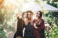 Three girls in a summer park