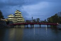 Matsumoto Castle with the red bridge at night in Matsumoto, Japan
