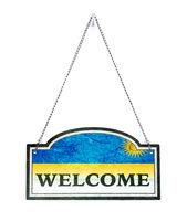 Rwanda welcomes you! Old metal sign isolated