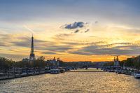 Paris France city skyline sunset at Seine River with Pont Alexandre III bridge and Eiffel Tower