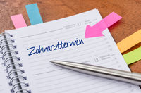 Daily planner with the entry Dentist appointment - Zahnarzttermin (German)