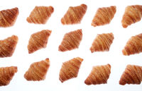Bakery fresh croissants pattern on a white background.