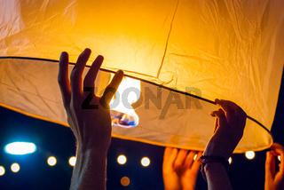 Lighting up a lantern, Chiang Mai