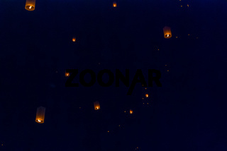 Light up lanterns flying to the sky at night
