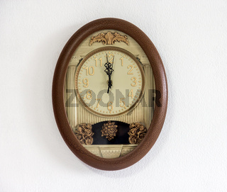 clock with pendulum hanging at the wall