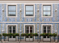Traditional ceramic tiles decorate exterior of large house in Lisbon