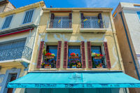 Residential house, restaurant, windows, awning, turquoise.