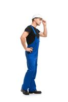 Man in blue work overolls and helmet isolated view
