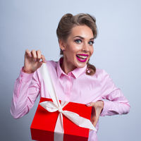 Funny woman unpacks gift