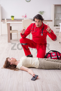 Young male paramedic visiting young woman