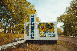 Chornobyl city road sign in exclusion zone. Radioactive zone in Pripyat city - abandoned ghost town. Chernobyl history of catastrophe. Lost place in Ukraine, USSR