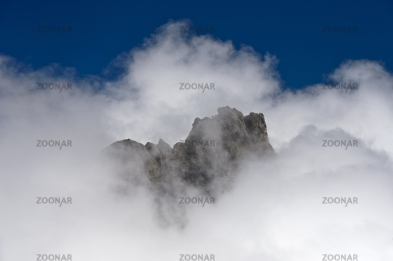 Peaks of the Pennine Alps in the clouds, Ovronnaz, Valais, Switzerland