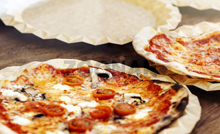 Freshly baked margherita pizza topped with tomato sauce, mozzarella and mushrooms.