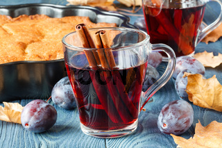 Hot alcohol for cold day with plum pie