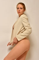 Portrait of the beautiful naked woman only in jacket